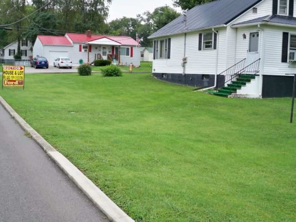 Absolute auction of house lot for T t motors somerset kentucky