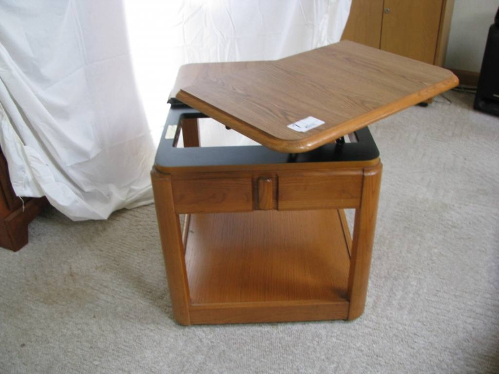 Solid oak end table with swivel top on wheels